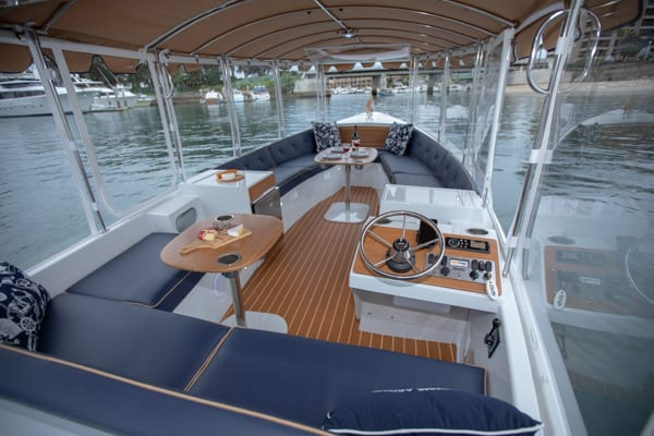 Photo of interior of Duffy Electric Boat 22 foot Bay Island model from the back looking forward.
